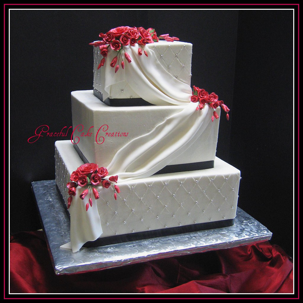 Square Black and White Wedding Cake with Red Roses