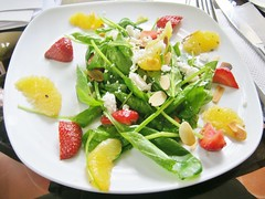 Baby Spinach with Strawberries, Oranges, toasted Almonds and Balsamic Vinaigrette at Pangea