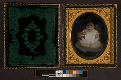 Portrait of baby, adult arm holding child | by George Eastman Museum