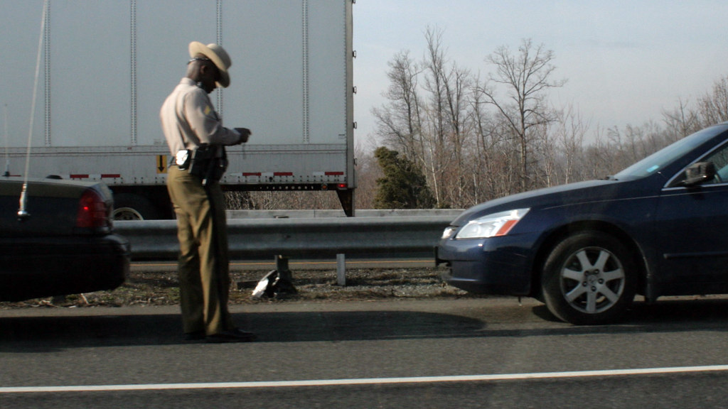 police trooper writing a ticket how to fight a traffic tic flickr. Black Bedroom Furniture Sets. Home Design Ideas