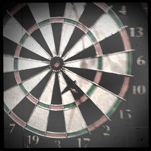 Dart Board And Darts In A Room