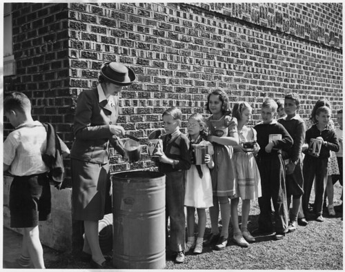Saturday's a Holiday for Most of the Nation's Small Fry, but to These Youngsters of Roanoke, Va. It's Fat-Collection Day. ca. 10/1942 | by The U.S. National Archives