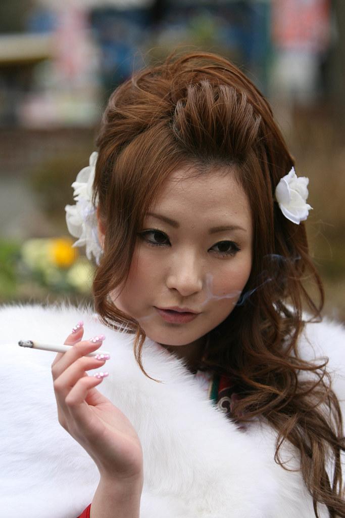 Japanese lady | Tokyo jan 11 -A Japanese woman smokes a ...