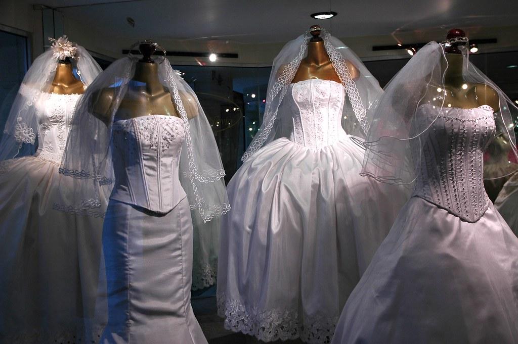 White wedding dresses and veils on display original desi for How to display a wedding dress