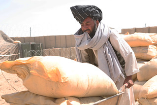 Marjah farmer wheels out bags of fertilizer | by United States Marine Corps Official Page