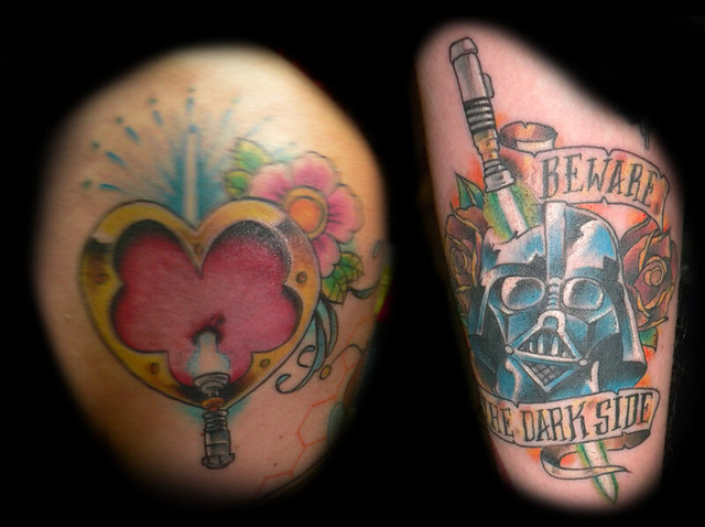 Star wars lightsaber hear and vader tattoos did these on for Matching star wars tattoos