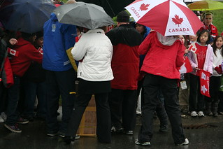 2010 Winter Olympics Torch Relay in Burnaby.. lots of umbrellas.. | by iwona_kellie