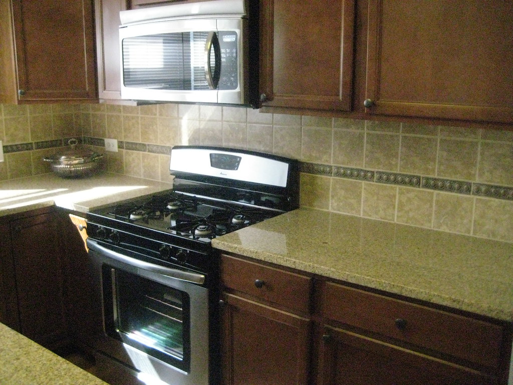 brand new kitchen cabinets we painted our brand new. Black Bedroom Furniture Sets. Home Design Ideas