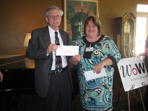 Maureen presents Scott Hackmeyer  from Devereux Kids a check | by United Way of Marion County