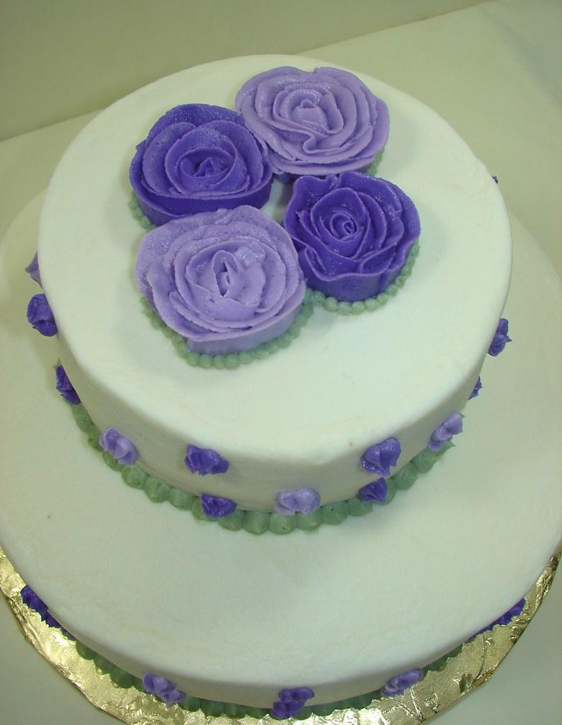 white buttercream finish bridal shower cake with purple flowers by jmc custom cakes