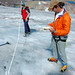 Scientists using ablation sticks to measure the retreat of Sperry Glacier
