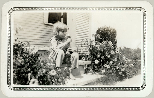 Barefoot child with flowers