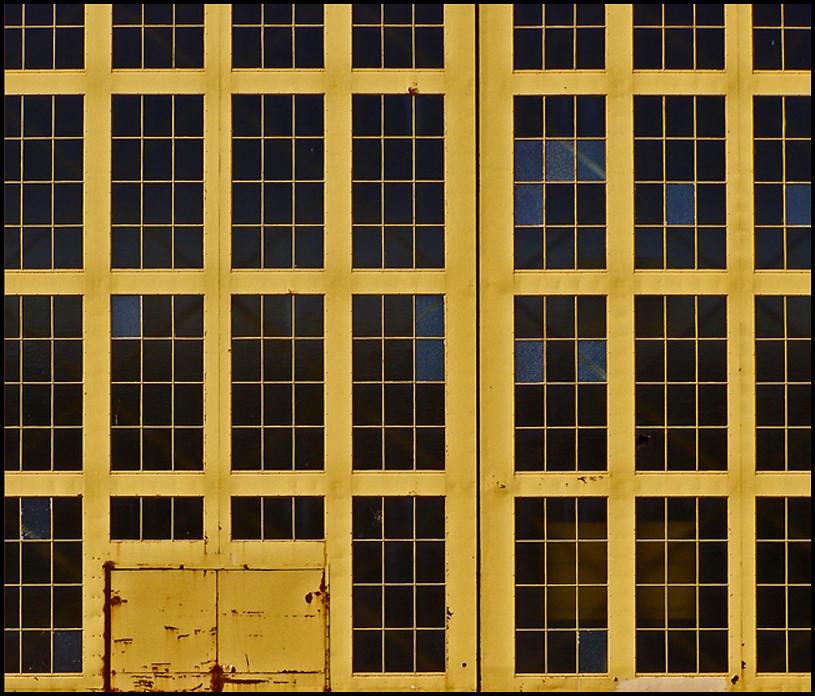 Yellow Notice On Front Door: Photo - Yellow Hangar Doors