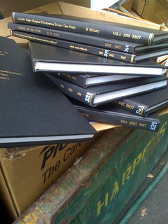 A pile of theses in a skip.
