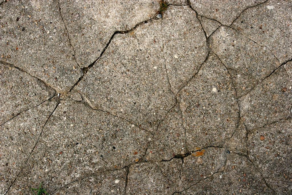 Cracked Concrete Texture Closeup Of Cracked Concrete