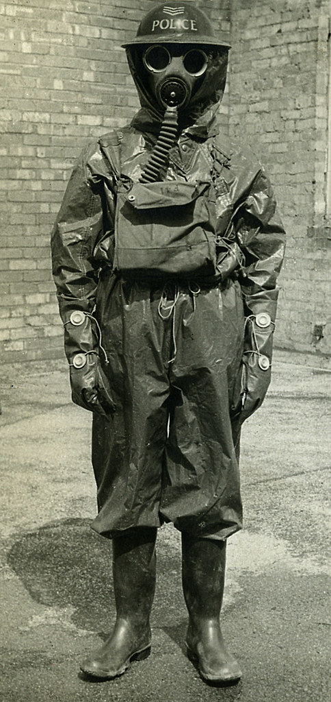 gas suit a sergeant of manchester city police poses in