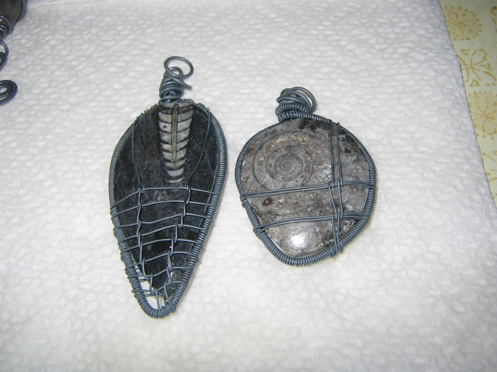Wire wrapped pendants after oxidition and before polishing… | Flickr