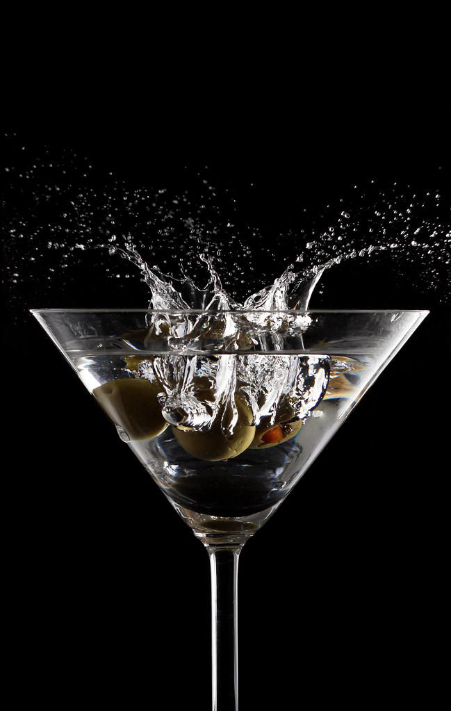 Martini splash in glass — Stock Photo © artjazz #9860399