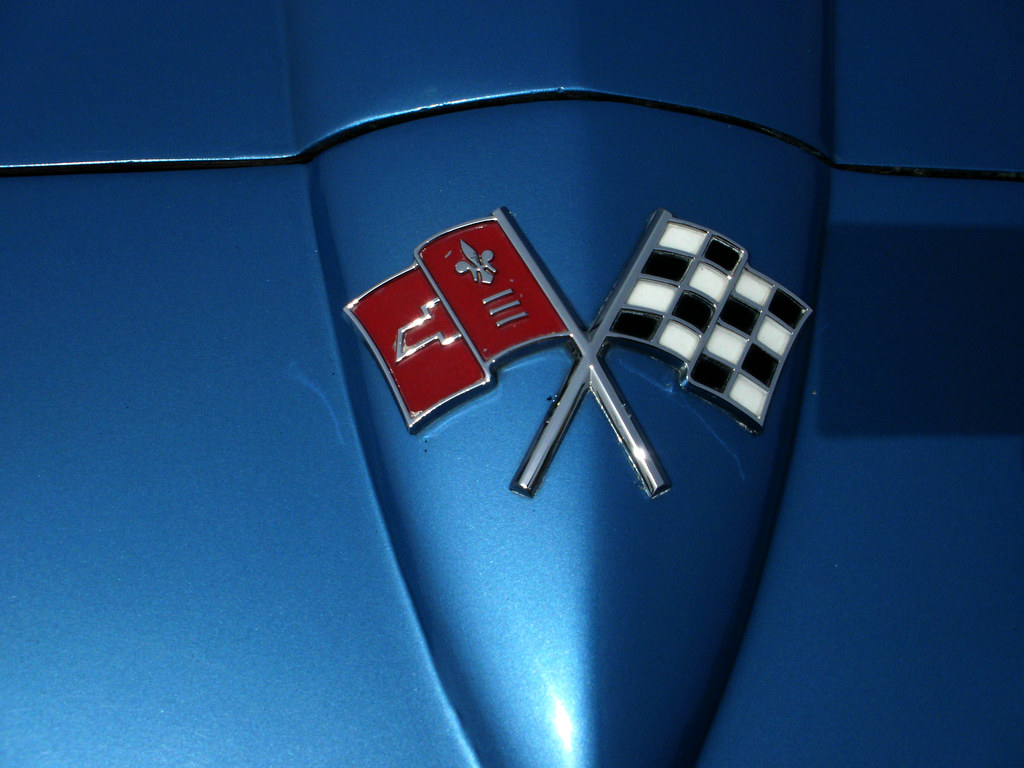 The Crossed Flags Emblem On The Nose Of A 1965 Chevrolet C