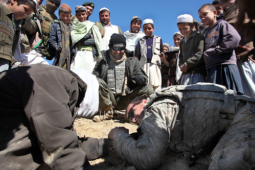 Friendly arm-wrestling in Afghanistan | by The U.S. Army
