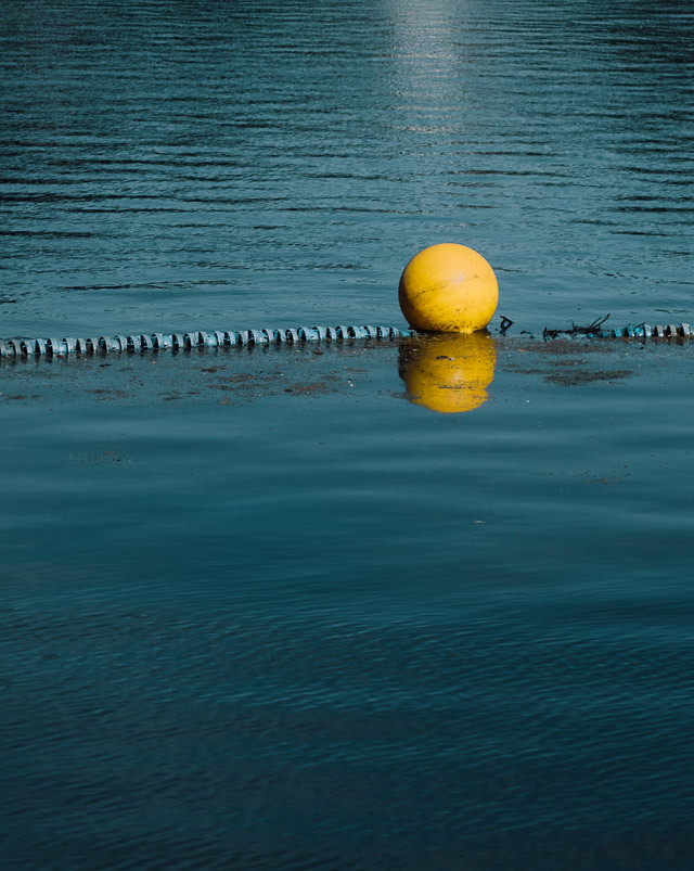yellow buoy on water
