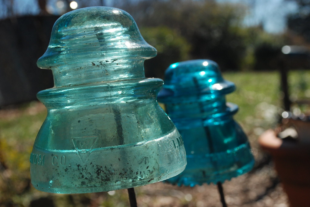 Garden Junk Old Electric Insulators On Metal Stakes I