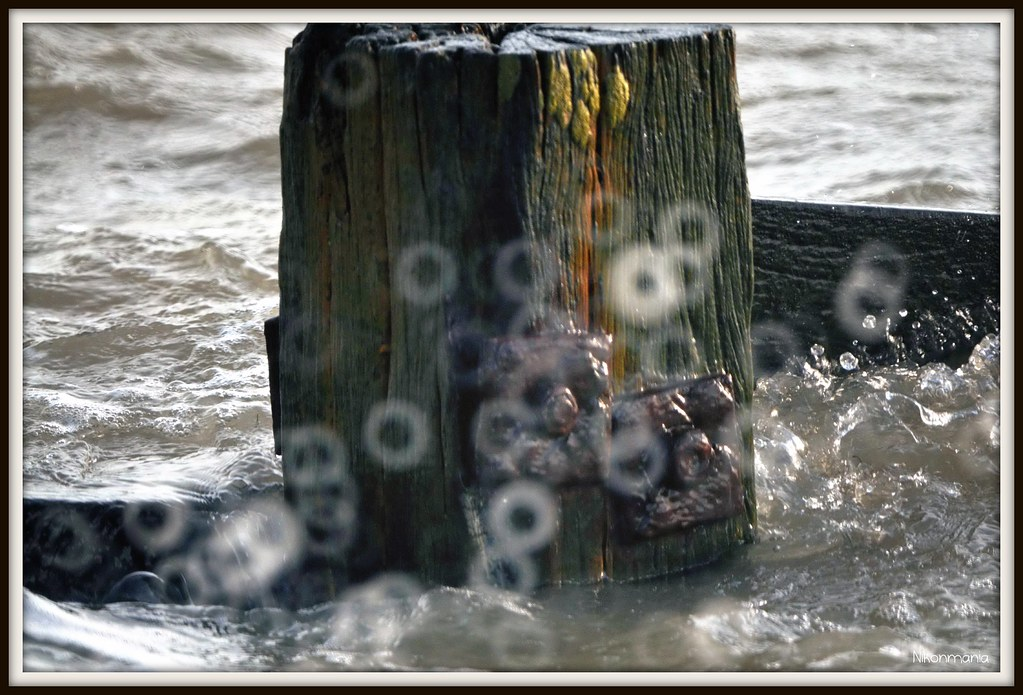Breakwater With Bokeh Effect From The Sea. 500mm Mirror Le