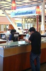 Help at the information desk. | by San José Public Library