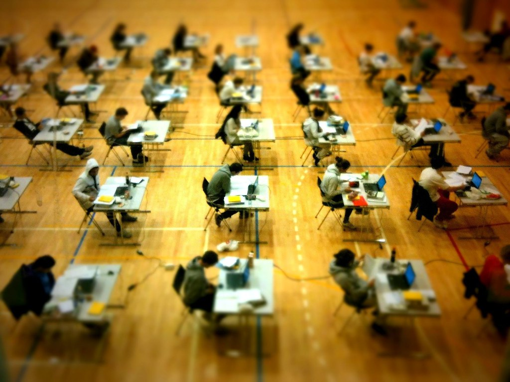 photo of students taking an exam.