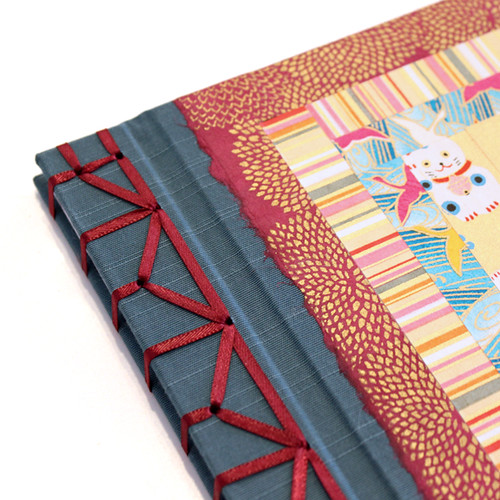 Japanese Paper Book Cover : Closeup of the hemp leaf binding i was commissioned to