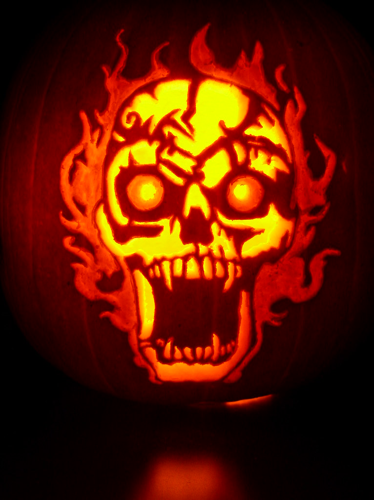 Fiery skull pumpkin carved for halloween an old
