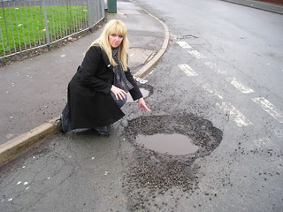 Val Kelly with a huge Eccles pothole | by Salford Liberal Democrats