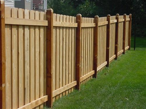 Board over western red cedar wood fence side