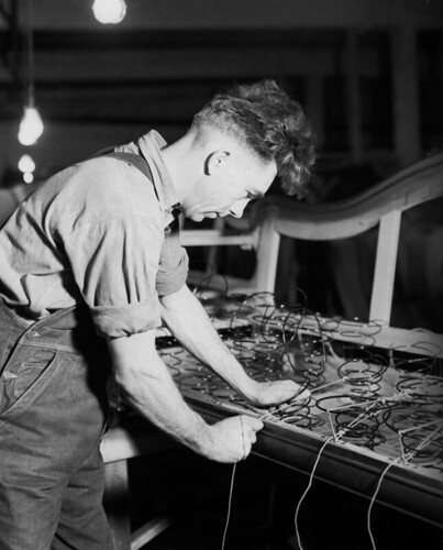 Furniture manufacturing caption worker ties springs on for Furniture history society
