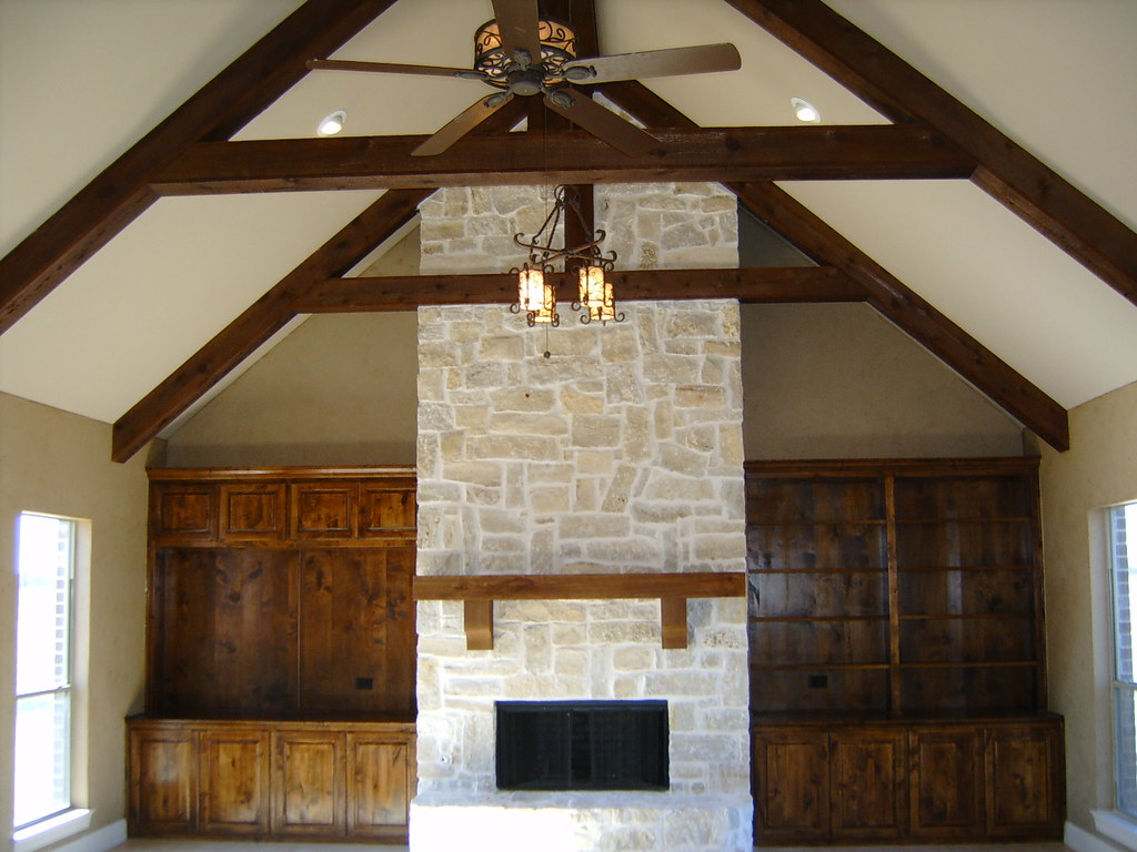 cathedral beam ceiling stone fireplace built ins samsung d