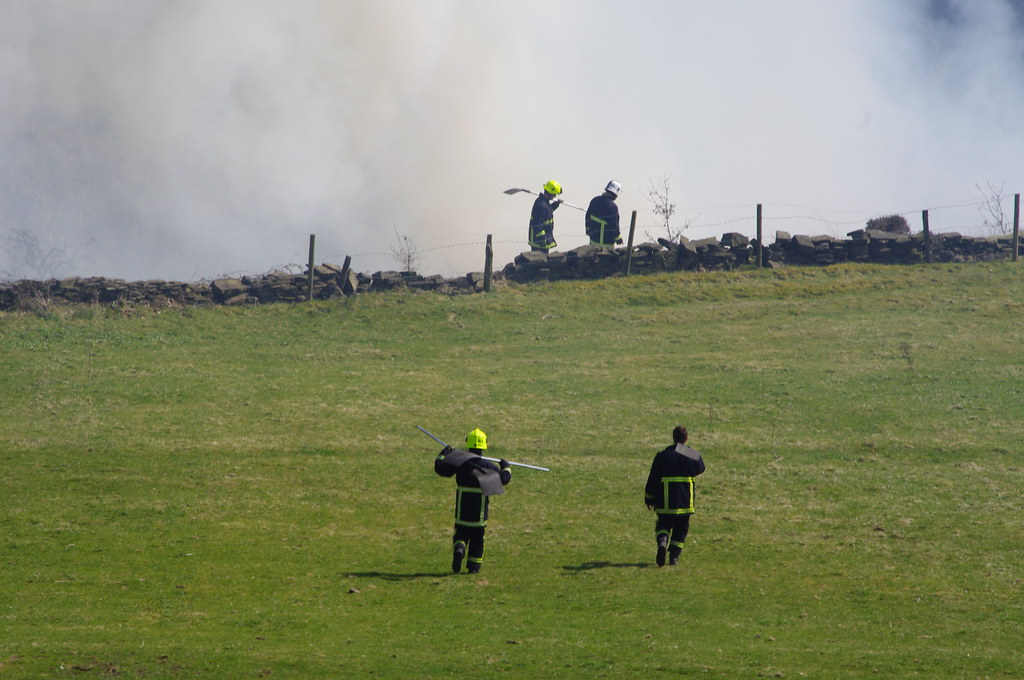 Firefighters walking across the fields down to the dale wi