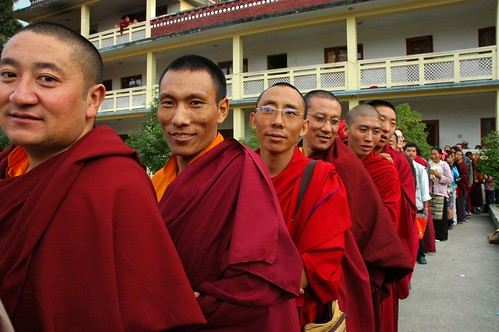 Pleased and happy Tibetan monks, in a line waiting for long life blessing, with leity, Tibetan people, Sakya Lamdre, Tharlam Monastery Courtyard, Tibetan Buddhism, Boudha, Kathmandu, Nepal | by Wonderlane