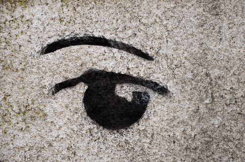 Black stencil of an eye and eyebrow | by Horia Varlan