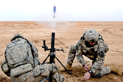 Firing a 60 mm mortar round near Forward Operating Base Grizzly, Iraq | by The U.S. Army