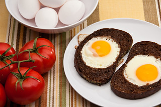 Sunny side up eggs in  toast | by Iza Korwel