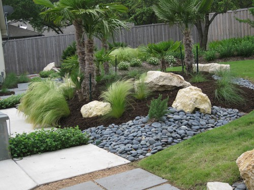 Design focal point w limestone boulders mexican beach peb for Beach rocks for landscaping