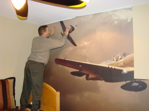 Airplane wall mural installation photos of a custom wall for Aviation wall mural