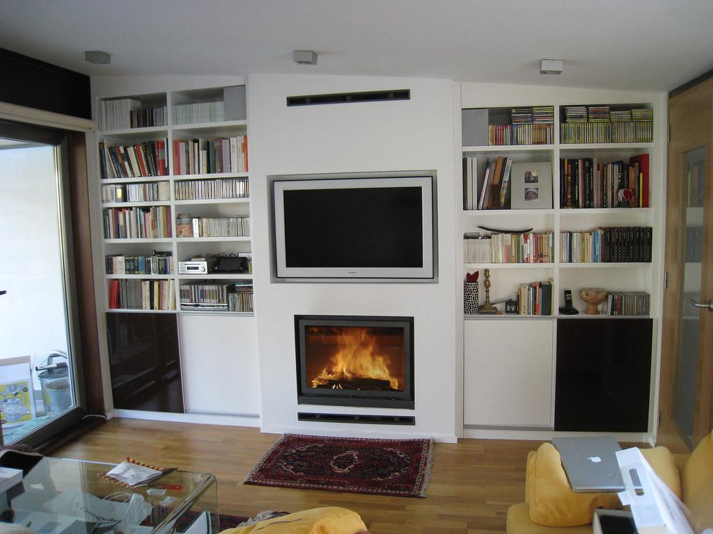 Chimenea quento con stuv 16 78 y tv integrada www - Muebles de salon con chimenea integrada ...