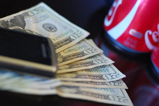 Money, cell phone and soda | by espensorvik