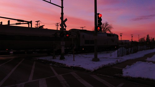 The northbound Amtrak Hiawatha crossing Chestnut Avenue at sunset. Glenview Illinois. February 2010. | by Eddie from Chicago