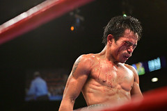 Manny Pacquiao walks to his corner after being hit by Erik Morales on March 19, 2005 in Las Vegas. (Photo by: AP)