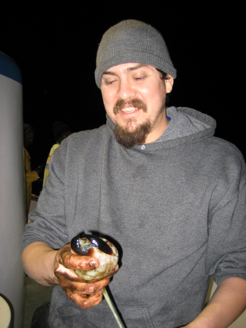 A squid 39 s mouth walter martinez from fontana holds the for Davey s locker fish report