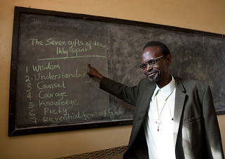 Priest showing the 7 gifts of the Holy Spirit on a blackboard, Kigali, Rwanda | by Eric Lafforgue