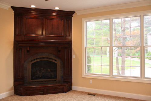 Panelized Corner Fireplace with Raised Hearth ...