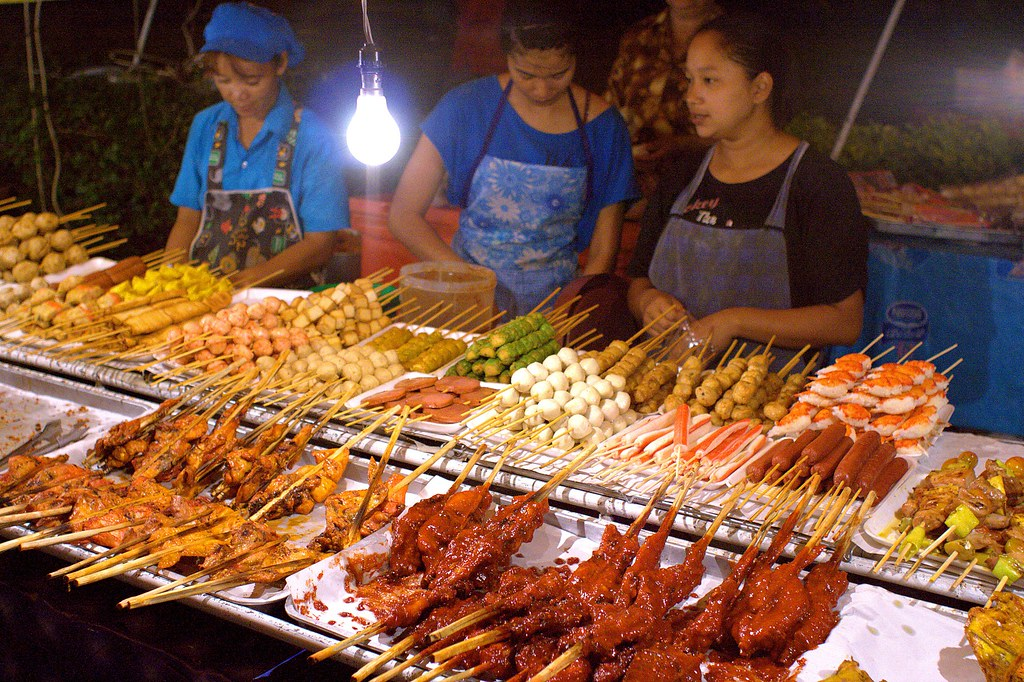 Night market near Kata Beach | Woman selling sweet pastry ...
